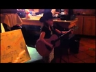 8 year old girl, Kayden-Harmony, sings and plays guitar on stage at Italian restaurant..